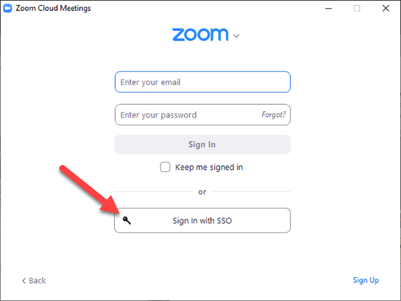 """Screencapture showing the Zoom software login screen, with an arrow pointing to the """"Sign in with SSO"""" button."""