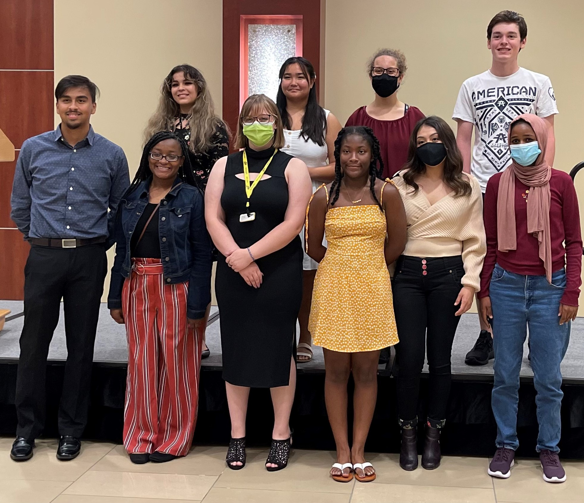 A picture of 10 students who received the Shocker Neighborhood Promise Scholarship.