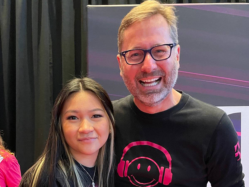 (Left to right) Picture of Wichita State University senior Truc Nguyen and T-Mobile for Business CEO Mike Sievert.