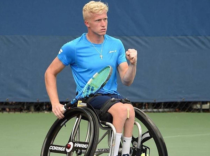 Pictured Casey Ratzlaff playing tennis on the court.