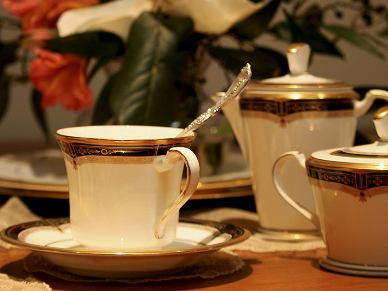 """Presidential china to be displayed at the scholarship-benefit tea is Noritake's """"Gold and Sable"""" pattern."""