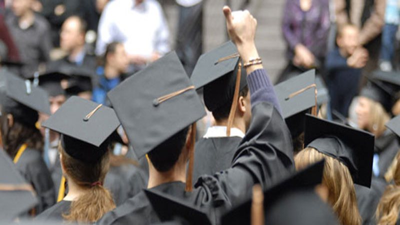 Picture of students from behind at graduation.