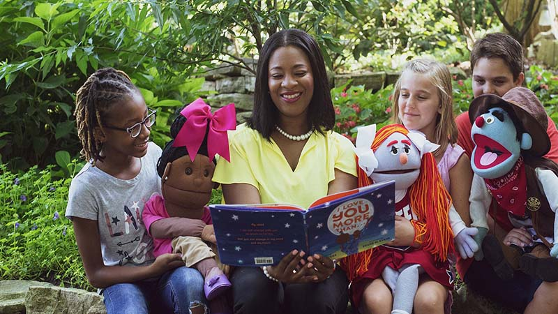 Prisca Barnes, founder and CEO of Storytime Village, reads to children.