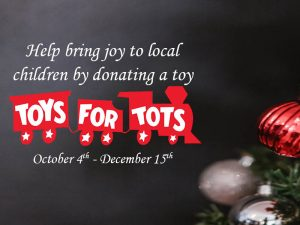 """A Christmas tree background with the words """"Help bring joy to local children by donating a toy Toys-for-Tots October 4th-December 15th"""""""