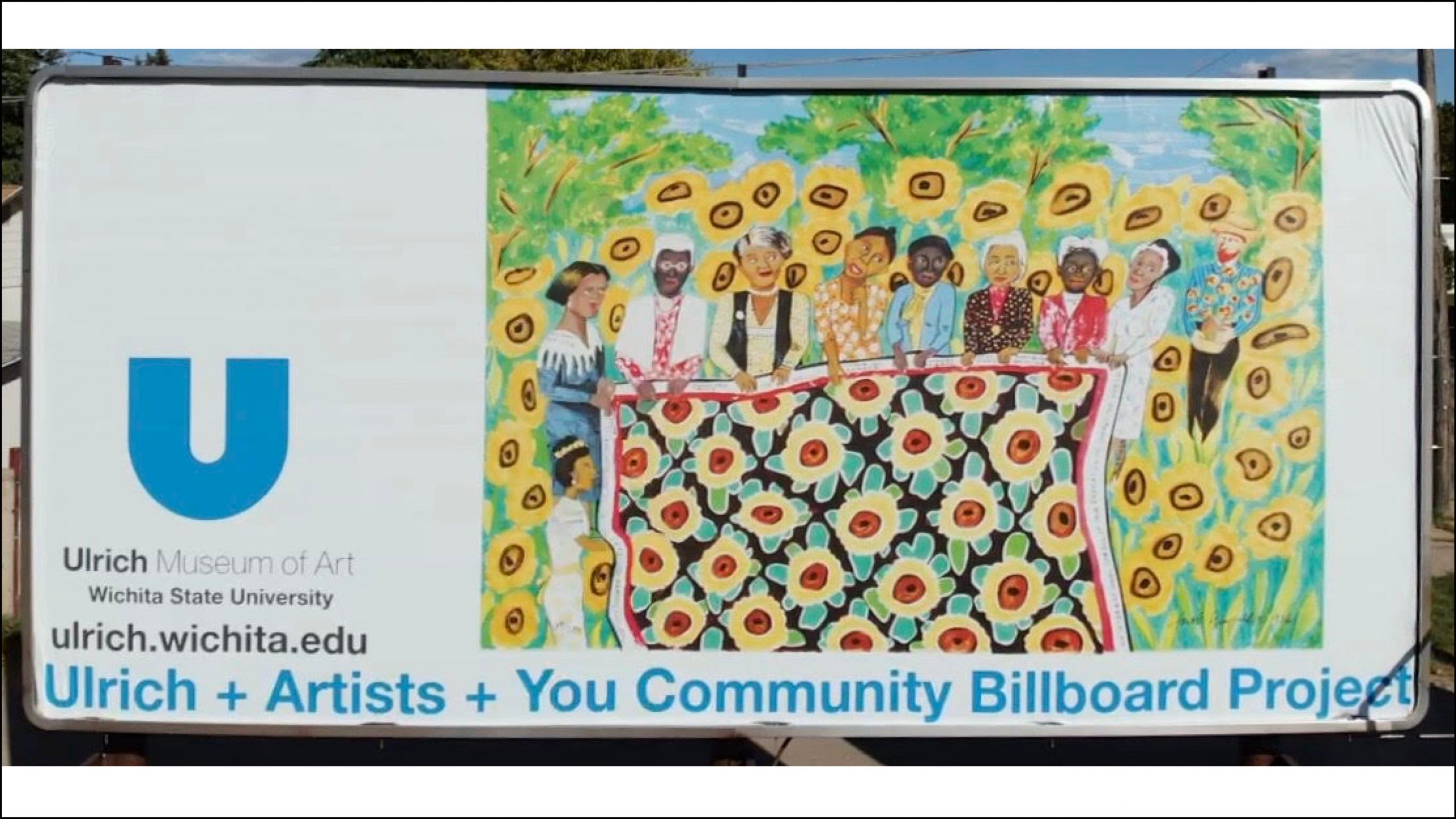 """A photo of the Ulrich billboard featuring artist Faith Ringgold's """"Sunflower Quilting Bee at Arles"""" (1996), which was located at 1400 E. Harry in Wichita."""