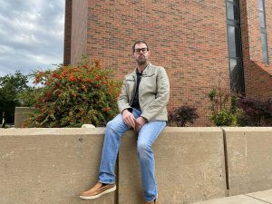 Photo of JW Webster, certified Cherokee language instructor at Wichita State, outside of Lindquist Hall.